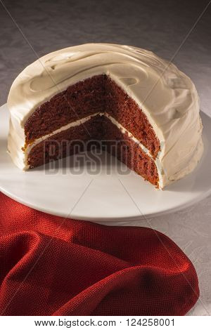 red velvet cake on cake stand with red napkin