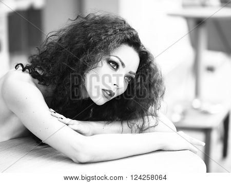 Gorgeous Young Woman Lying On Table