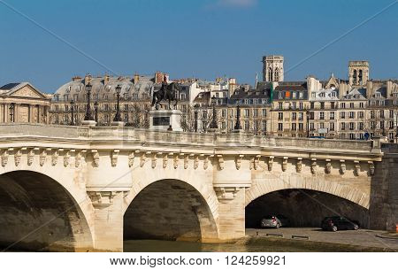 The pont Neuf is the oldest standing bridge across the river Seine in Paris.The bridge is composed of two separate spans one of five arches joining to the left bank to the Ile de la Cite another of seven joining the island to the right bank.