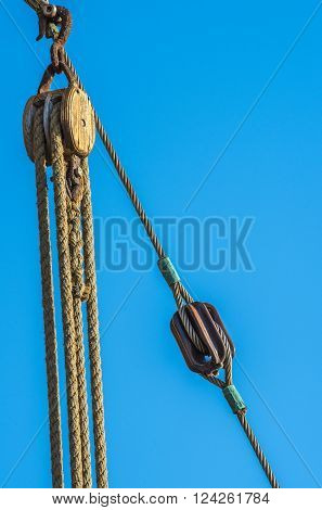 Ship's tackle on the mast of an old sailing ship in the Bay of Los Gigantes. Tenerife.