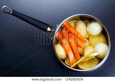 preparing vegetable stock bouillon in a pot.