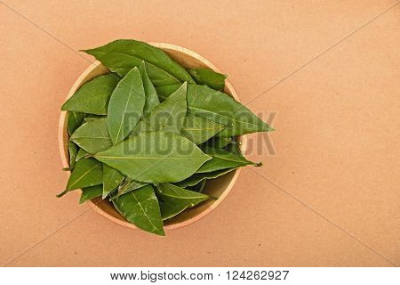 Bowl Of Bay Leaves On Kraft Paper