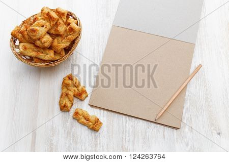 Plait Cookies. Puff Pastry, Near Notebook For Recipes And Pencil