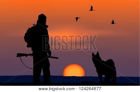 Silhouette of hunter with dog at sunset background