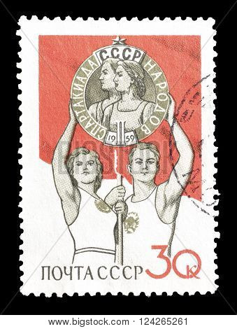 SOVIET UNION - CIRCA 1959 : Cancelled postage stamp printed by Soviet Union, that shows athletes.