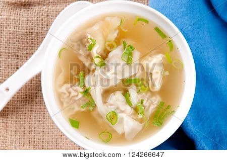 hand made won tons stuffed with pork in a delicious broth