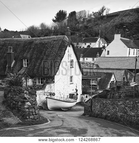 Black and white image of traditional English old fishing village