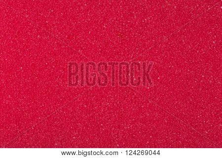 Red spongy porou rough macro texture background