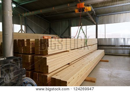 At sawmill. Image of warehouse lined with metal sheets