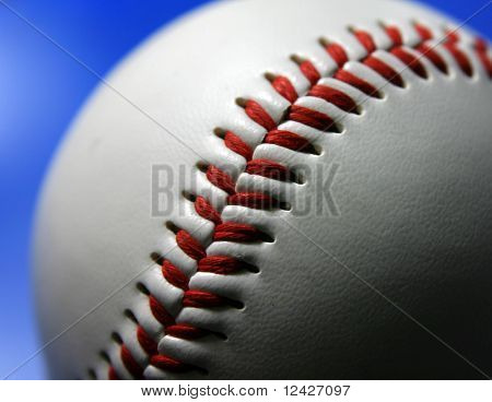 Closeup of baseball on blue background