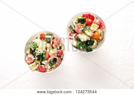 organic tomato and cucumber greek salad with feta and spanish onion