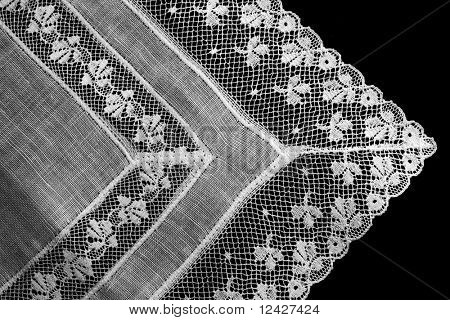 Lace handkerchief on velvet