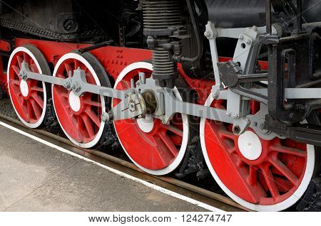 red wheels of steam locomotive-chassis vehicle.The locomotive is out of service.