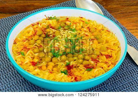 Healthy and diet food: White beans, canned peas, noodles, saffron. Studio Photo