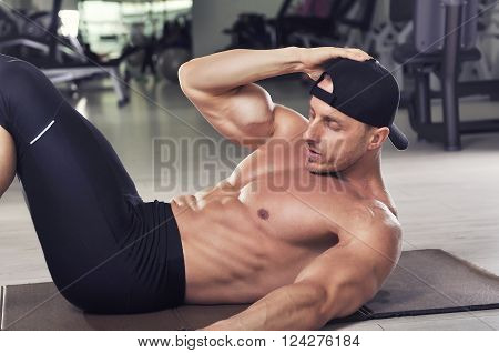 Handsome Powerful Athletic Man Performing Crunches. Strong Bodybuilder With Perfect Abs, Chest And B