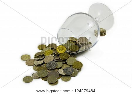 ruble coins falling out of a glass cup isolated