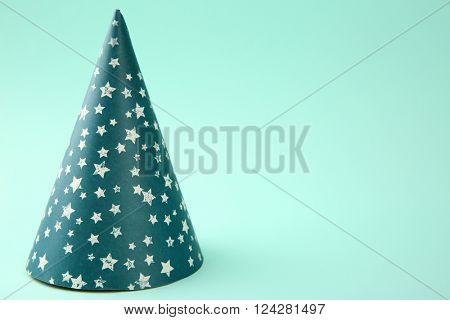 Birthday hat on light blue background
