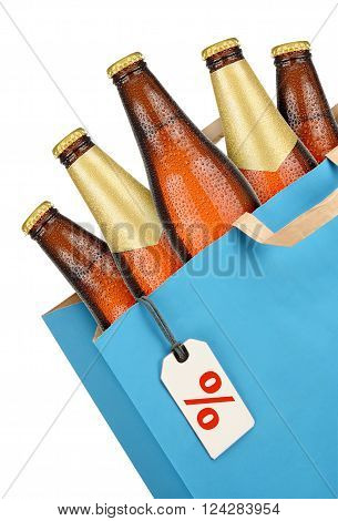 Grocery bag with brown beer bottles isolated on white background. Discount concept