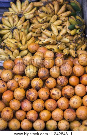 Oranges and bananas at open air fruit market in the village in Bali, Indonesia.