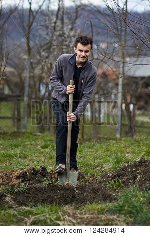 Teenage Farmer Planting Trees
