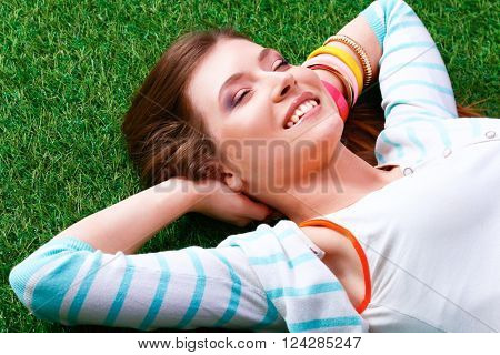 Beautiful young woman holding hands behind head