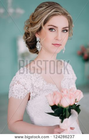 Portrait Of Bride In Flower Decor, Studio Photo. Beautiful Bride Portrait Wedding Makeup And Hairsty
