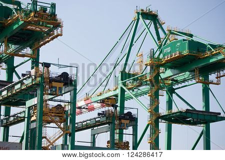 SANTOS SP/BRAZIL: AUGUST 30 - Green cranes at Santos seaport under blue sky