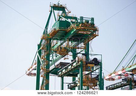SANTOS SP/BRAZIL: AUGUST 30 - Green crane at Santos seaport under blue sky