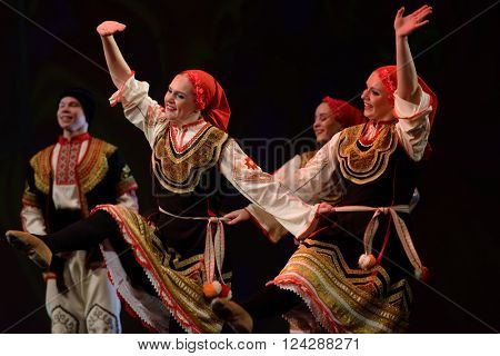ST. PETERSBURG, RUSSIA - MARCH 28, 2016: Young dancers perform Bulgarian dance at the opening ceremony of X International Festival of Choreographic Art Pari Grand