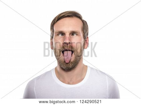 Man with his eyes crossed and funny face isolated on white.