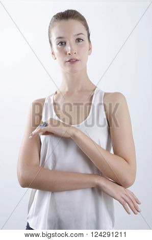 Beautiful woman portrait showing a paper boat ring