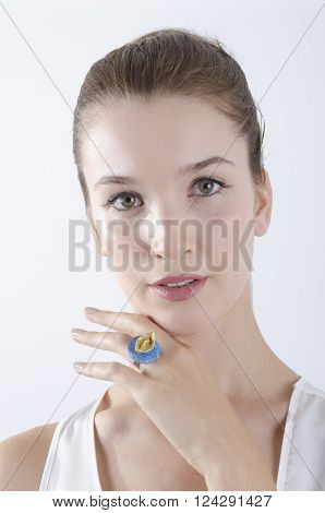 Close up of beautiful female hand wearing a paper boat ring