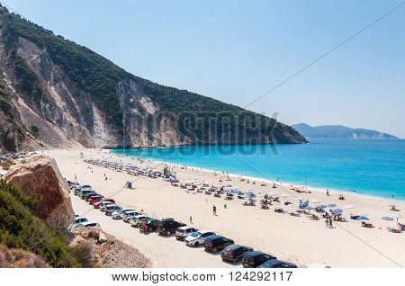 Myrtos beach Kefalonia Greece - August 30 2015: People rest on Myrtos beach - the most beautiful beach on Kefalonia Island.