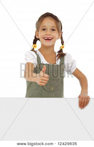 Little girl with an empty banner and thumb up sign