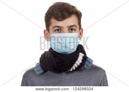Young man in a medical mask, flu disease. On white background