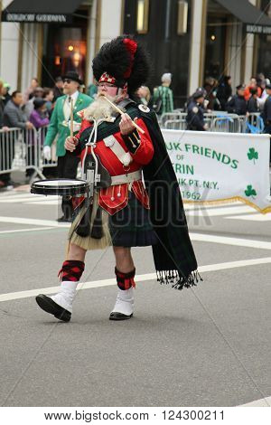 NEW YORK - MARCH 17, 2016: Amityville Highland Pipe Band marching at the St. Patrick's Day Parade in New York.
