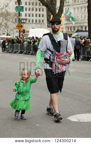 NEW YORK - MARCH 17, 2016: Families with young kids marching at the St. Patrick's Day Parade in New York