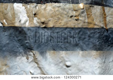Tan, slate, and off white striped rough, raised texture