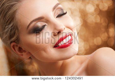 Blonde Beauty In Elegant Makeup.