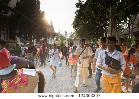 CHIANG MAI, THAILAND - APRIL 2: people participate in traditional buddhist monk ordination ceremony at Roy Jun temple in Chiang Mai, Thailand on April 2, 2016.