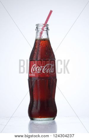 KUALA LUMPUR, MALAYSIA - Feb 17, 2016  cold coca cola bottle with straw on the white background