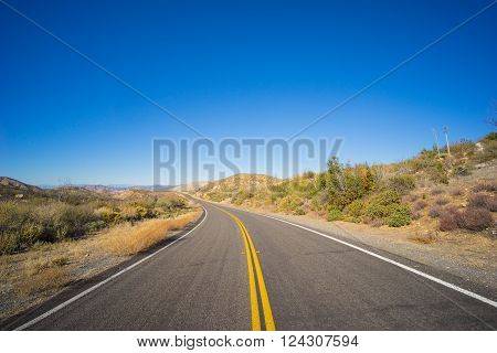 Bend in a desert highway located in the American southwest.