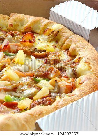 Closed Up Delicious Supreme Pizza in a box