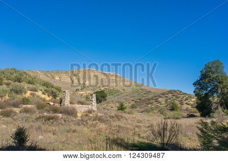 stone column remains of ranch house in Mojave desert of southern California.