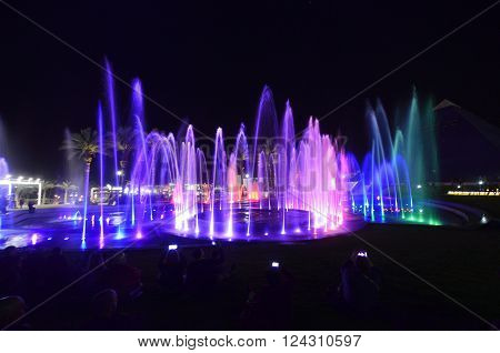 attraction colorful musical fountain jet in the night sky in Eilat