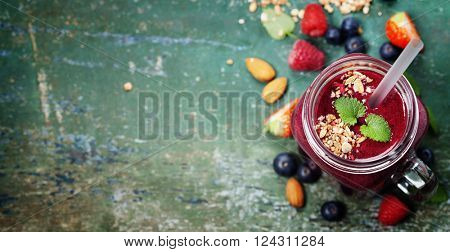 Berry smoothie on rustic  background - Healthy eating, Detox or Diet concept
