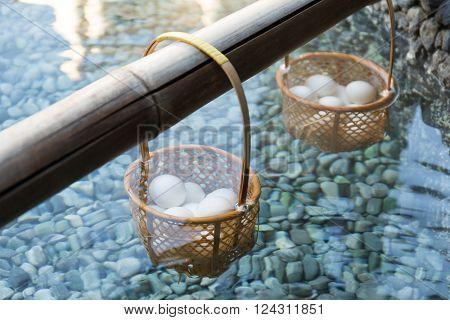 Japanese hot spring steam boil eggs inside basket