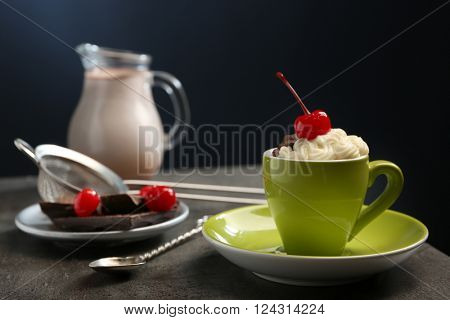 Chocolate cake in a mug with a cherry on top, close up