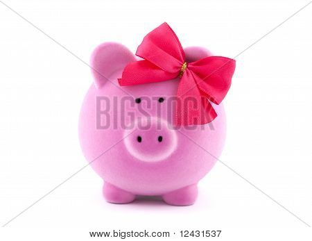Pink piggy bank with red bow