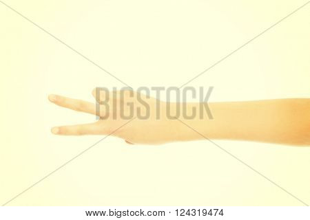 Woman's hand with two fingers